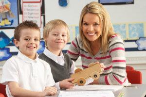 children and their teacher inside the classroom